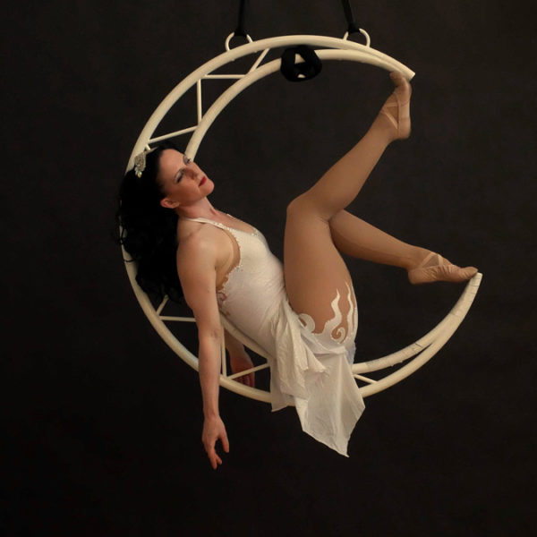 Aerial Moon - Ethereal aerial performance in a spinning crescent moon